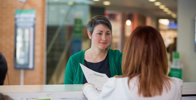 Lady at reception in a health service
