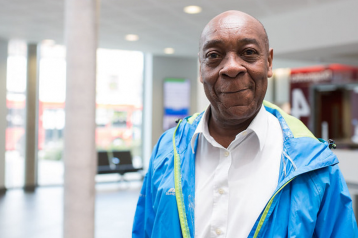 Older black man standing at a hospital ward