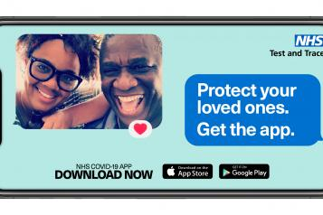 "Image of a smartphone screen. the left corner has a selfie of an older man with a younger woman, both smiling at the camera. The upper right corner has the NHS test and trace logo and a speech bubble ""Protect your loved ones. Get the App"""