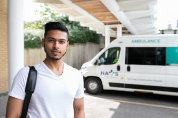 Man standing infront of an ambulance