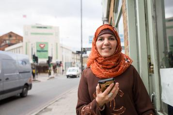 Smiling woman wearing hijab at a local street