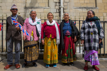 Five Gurkha Nepalese residents wearing traditional dress