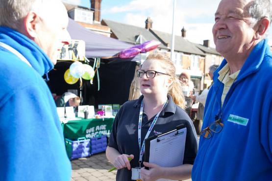 Volunteers talking to member of the public